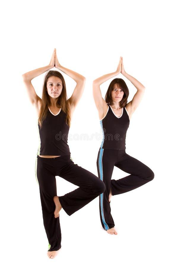 Womans, das Yoga tut stockfoto