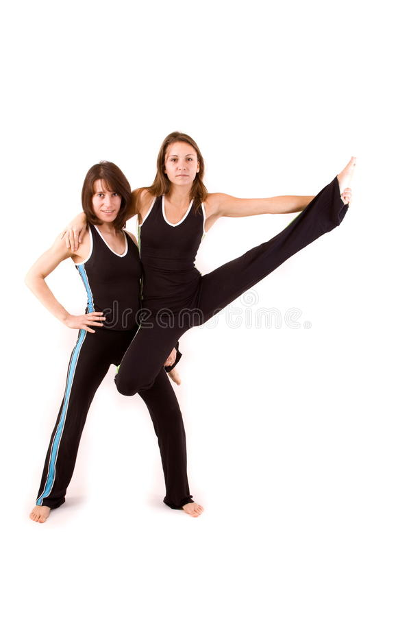 Womans doing yoga royalty free stock image