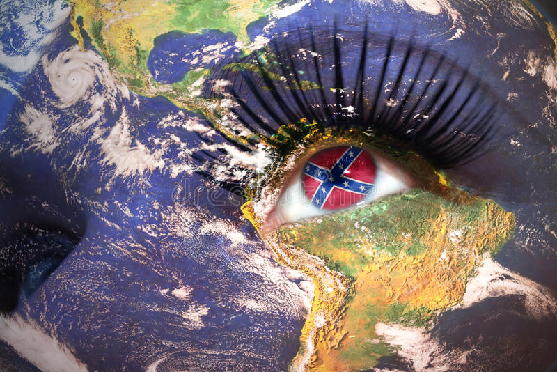 Womans face with planet Earth texture and confederate navy jack flag inside the eye. royalty free stock photography