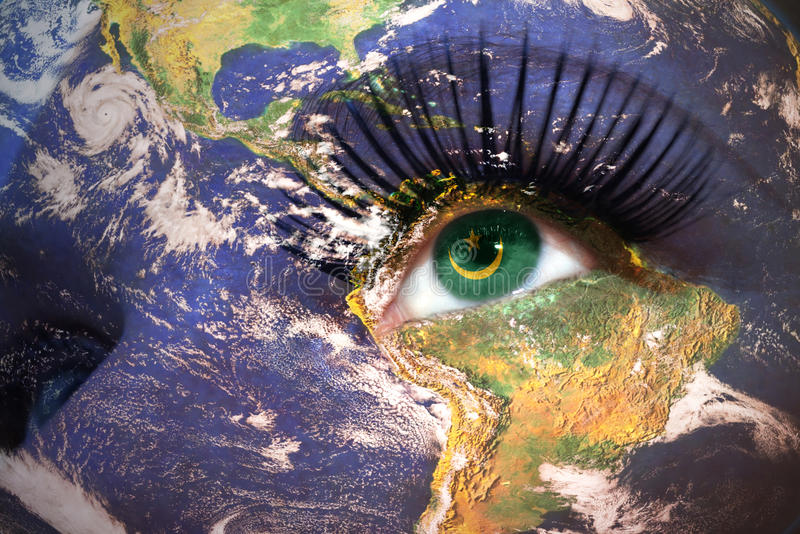 Womans face with planet Earth texture and mauritania flag inside the eye. stock photos