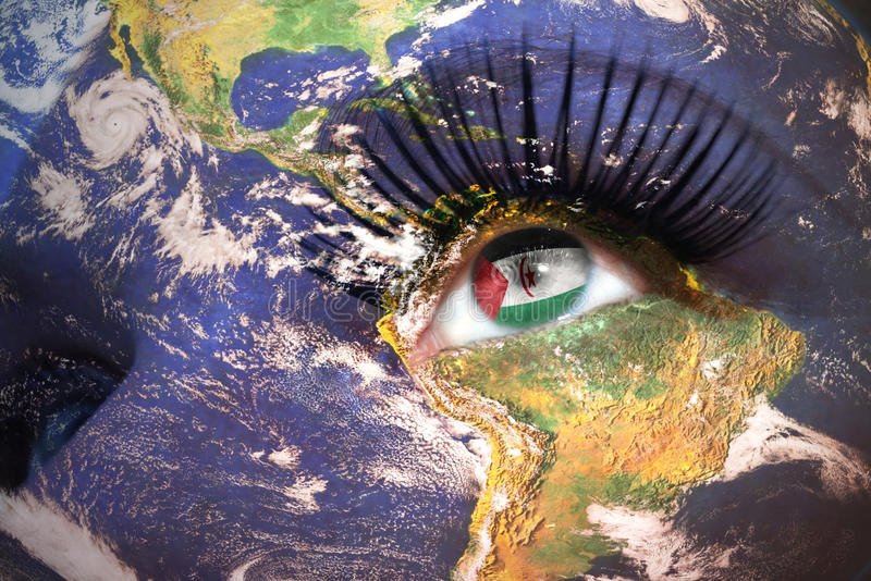Womans face with planet Earth texture and Sahrawi Arab Democratic Republic flag inside the eye. stock photo