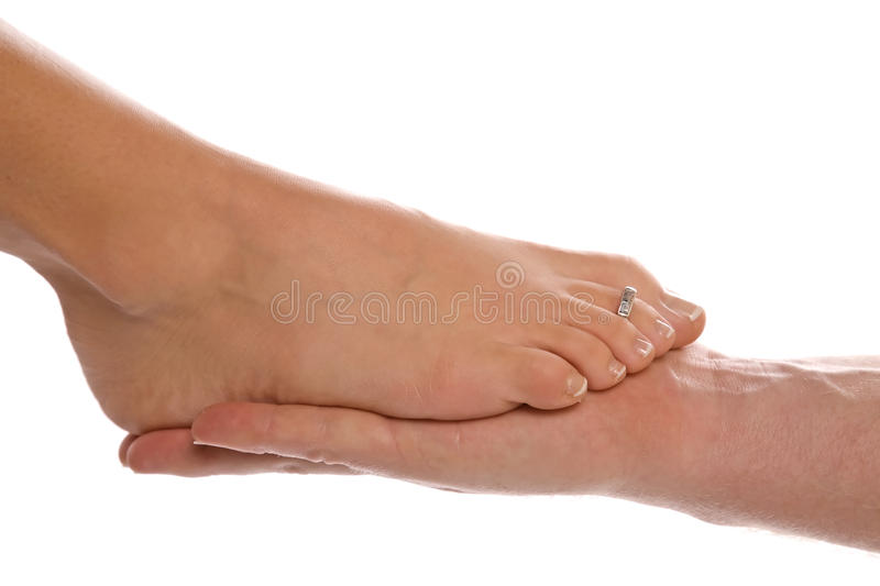 Download Womans foot on mans hand stock photo. Image of female - 11743272