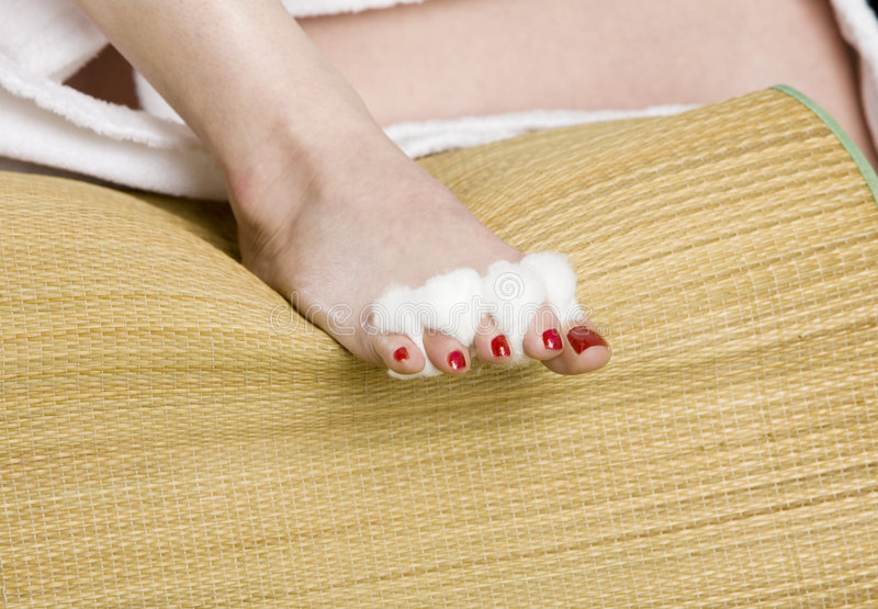 Womans foot with red nail polish royalty free stock photos