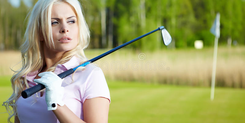 Womans golf arkivfoton