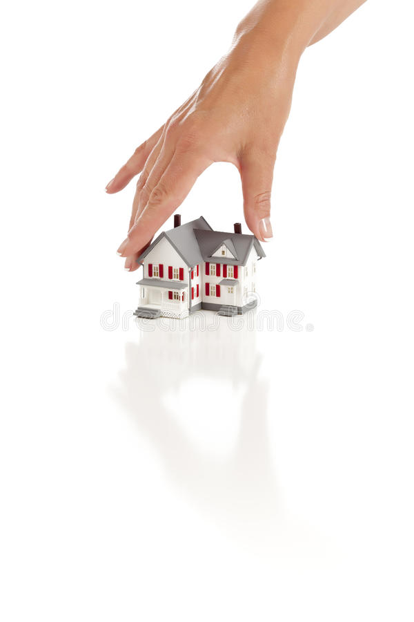 Womans Hand Choosing A Home On White Royalty Free Stock Images