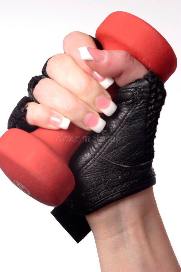 Womans Hand, Die Ein Gewicht Anhält Lizenzfreie Stockfotografie