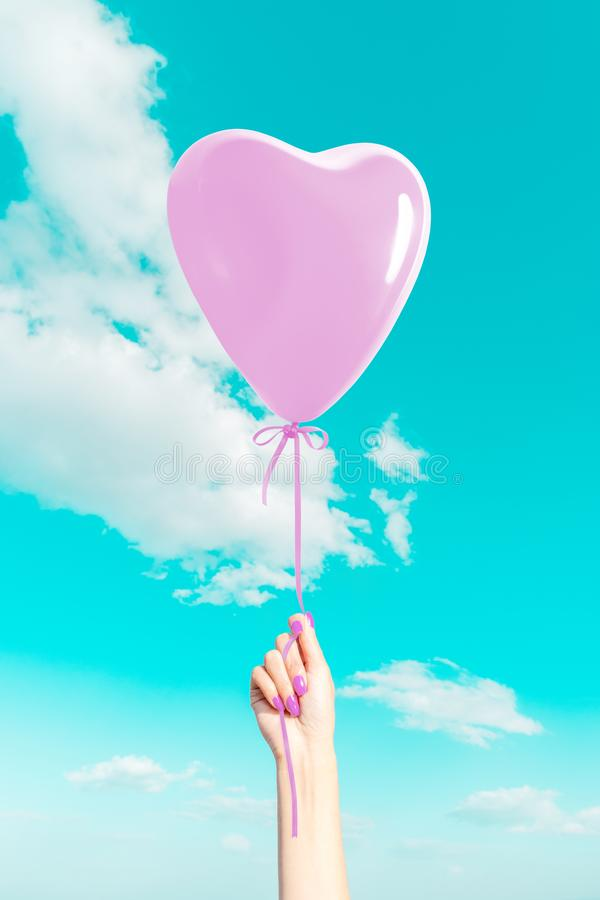 Womans hand with heart shaped balloon royalty free stock photos