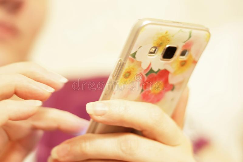 Woman`s hand hold smartphone and touch a screen royalty free stock photo