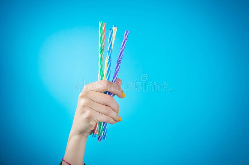 Womans hand holding straws royalty free stock photos
