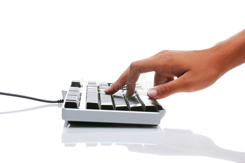 Womans Hand and Keyboard. Womans Hand on Computer Keyboard, isolated over white with reflection in tabletop stock photo