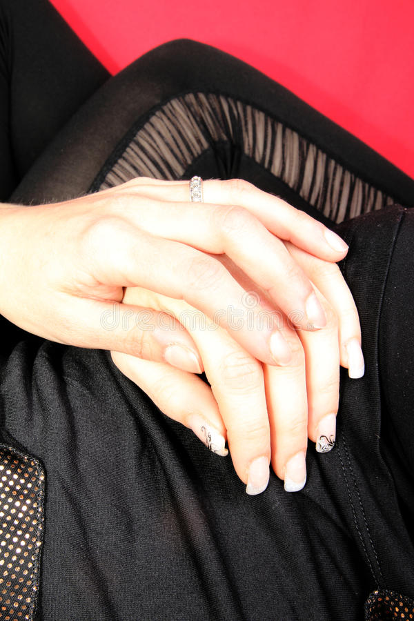 Womans hand. A womans hand in the legs stock image