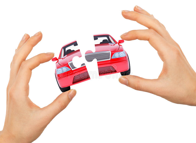 Womans hand making car puzzle. Isolated on white background stock photography