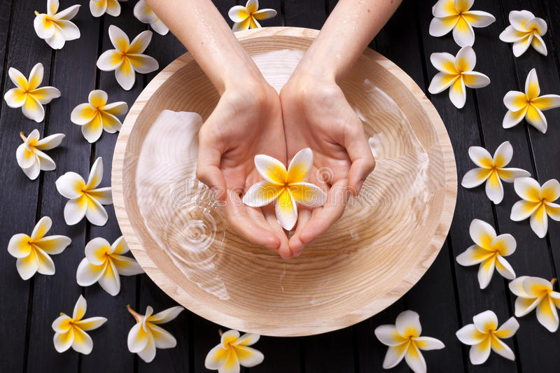 Spa Flowers Water Hands Treatment royalty free stock image