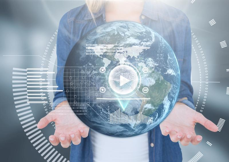 Womans open palm hands holding world earth globe interface technology. Digital composite of Womans open palm hands holding world earth globe interface technology stock image