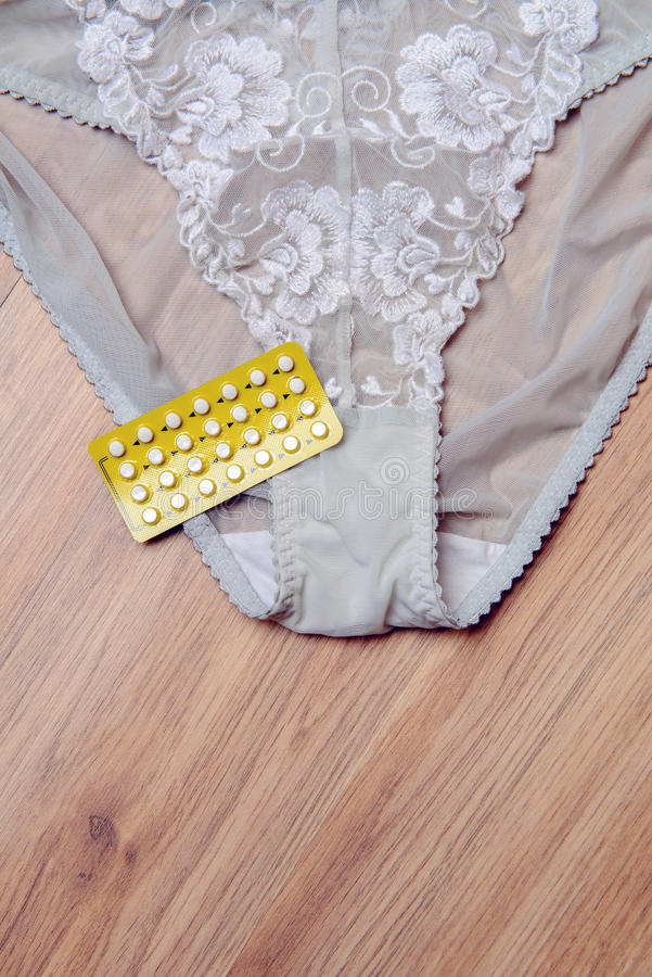 Download Womans Panties With Birth Control Pill Stock Photo - Image: 83704342