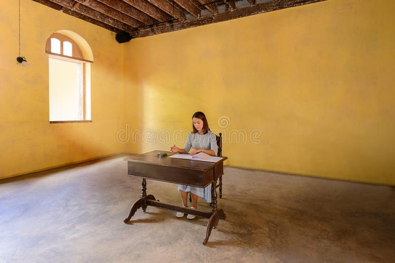 Womans signing a guest book with a pen royalty free stock photography