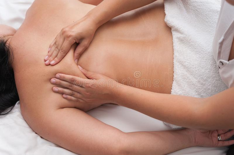 Womans in spa salon massage therapy and beauty treatments. Womans in spa salon. Traditional oriental massage therapy and beauty treatments stock photo