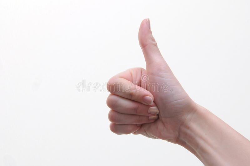 Womans thumb up. Woman shows someone thumb up royalty free stock photography