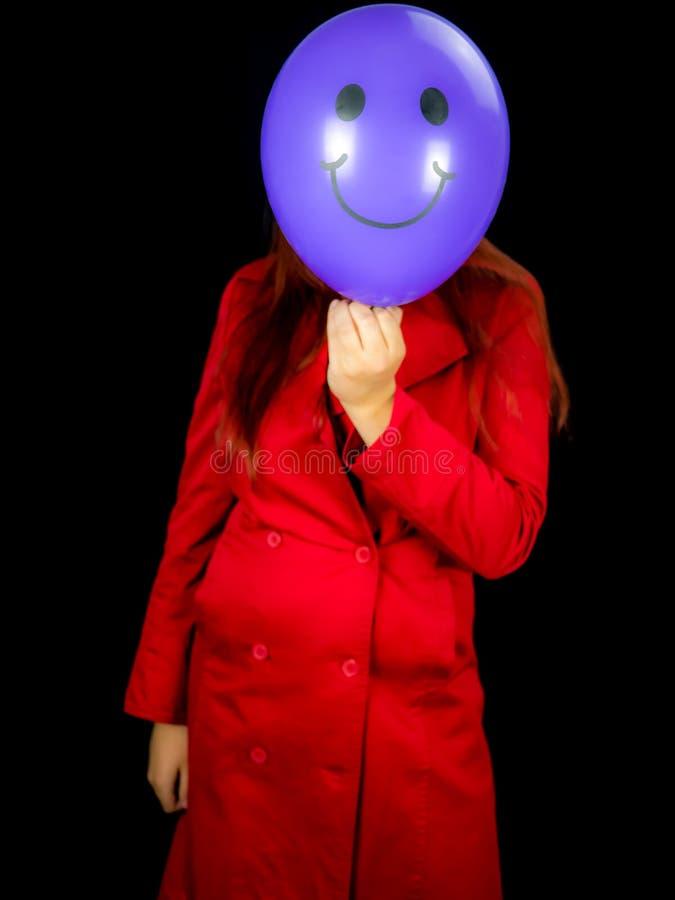 Womanshowing性交 而不是面孔的Baloon 免版税库存图片