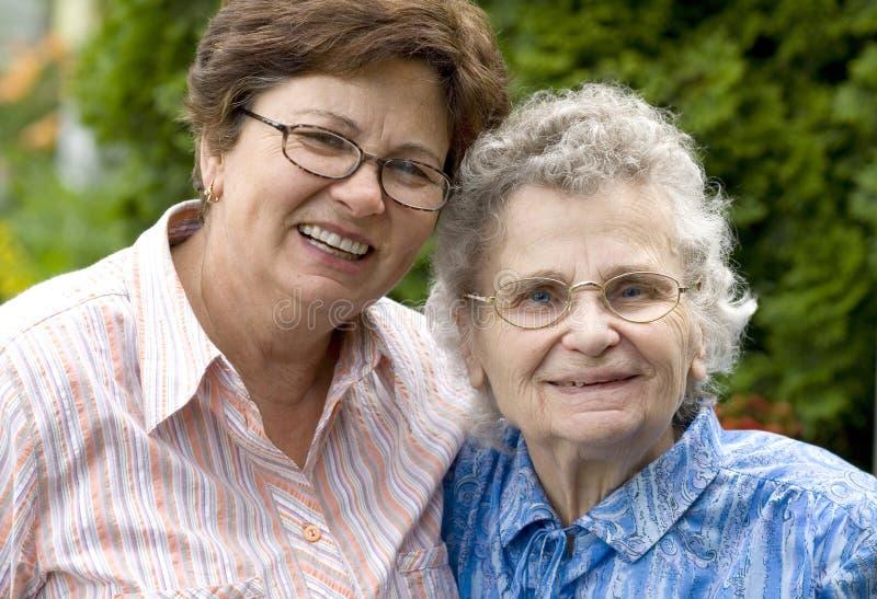 Women. Elderly woman with her daughter