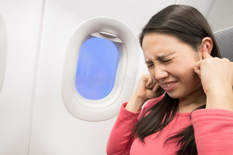 Women in airplane stock image