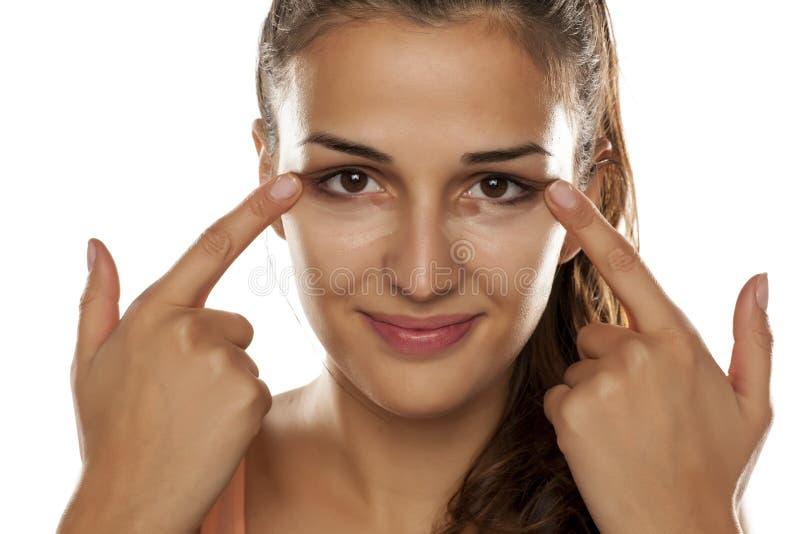 Women applying concealer royalty free stock image