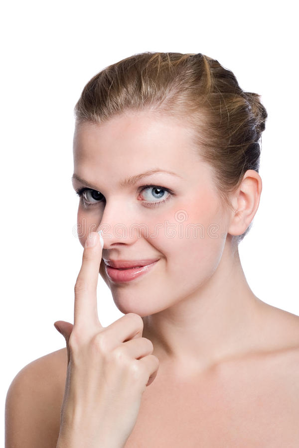 Women Applying Cream To Her Nose Royalty Free Stock Image