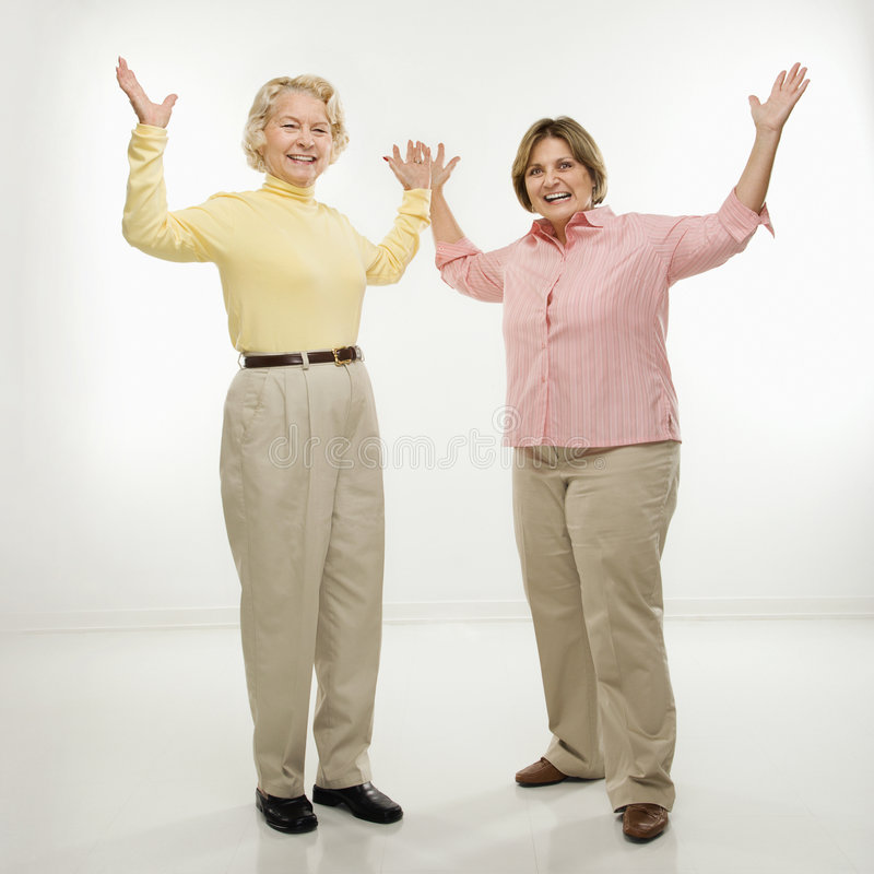 Women with arms in air. royalty free stock photography