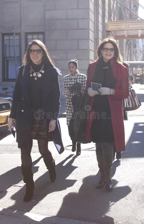 Women arriving together to the Oscar de la Renta fashion show in New York. City stock photos