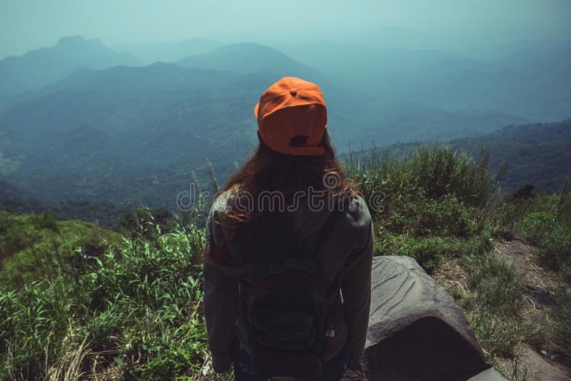 Women asians travel relax in the holiday. Watch the beauty wild nature wood on the mountain.  stock photo