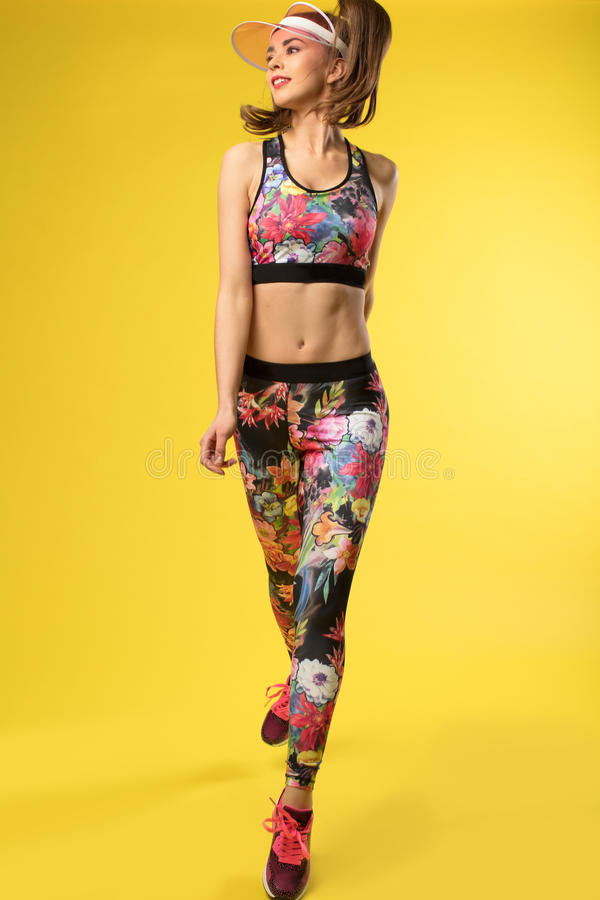 Women with attractive body on the yellow background. stock photo