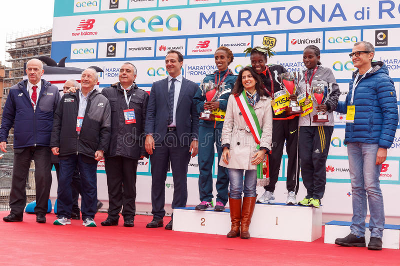Women Award race with Virginia Raggi and other authorities. Rome, Italy - April 2, 2017: The mayor of Rome Virginia Raggi and other authorities, on stage with stock photo