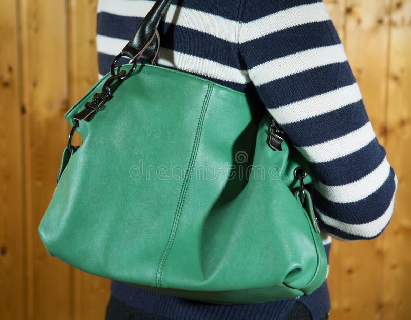 Women bag close up hanging on a woman. 's shoulder royalty free stock photos