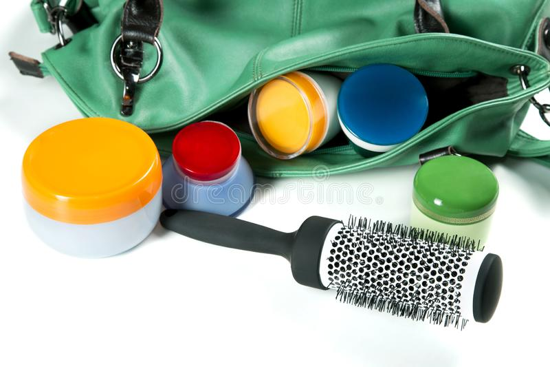 Women bag comb and jars of creams on a white. Background royalty free stock photos