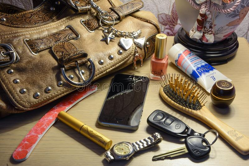 Women bag and its contents. Cosmetics, phone, key royalty free stock photos