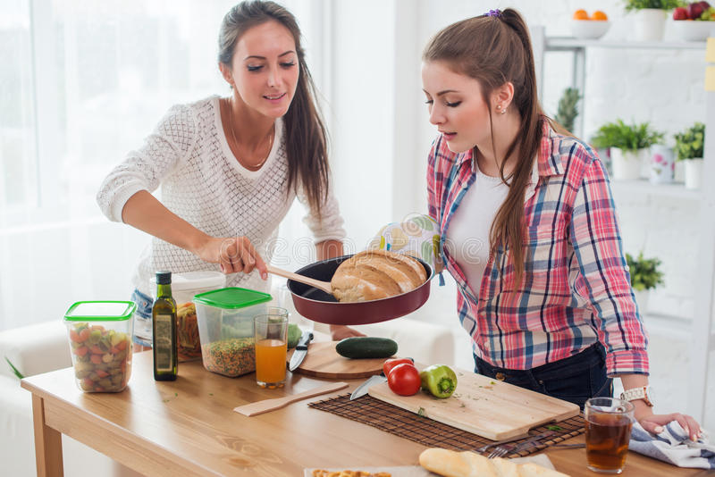 Women baking at home fresh bread in kitchen concept cooking, culinary. stock images