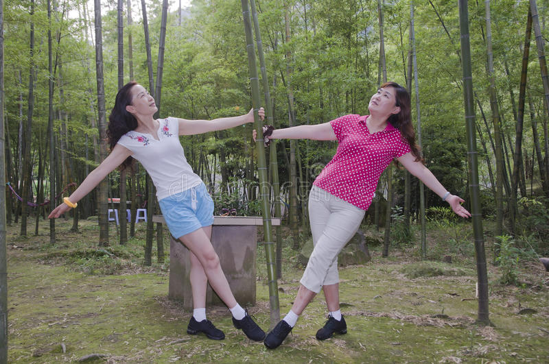 Women In Bamboo Forest Stock Photo
