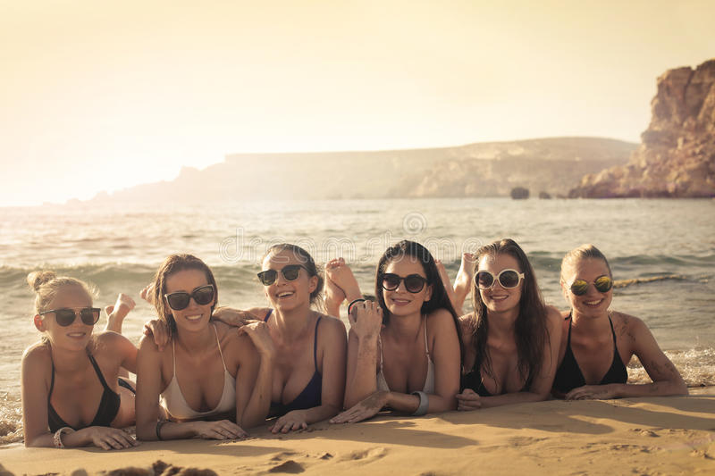 Women on the beach royalty free stock photography