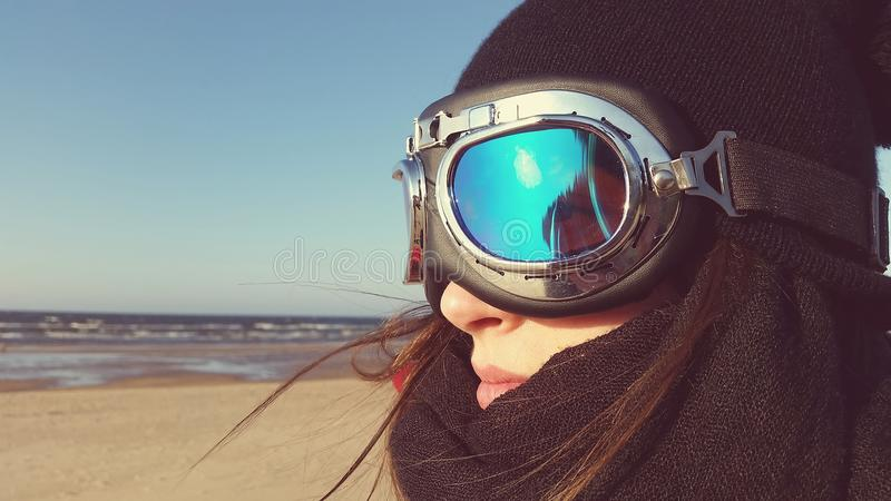 Women at beach with moto glasses stock photo
