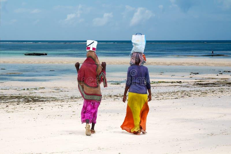 Women at the beach, Zanzibar island, Tanzania stock photography