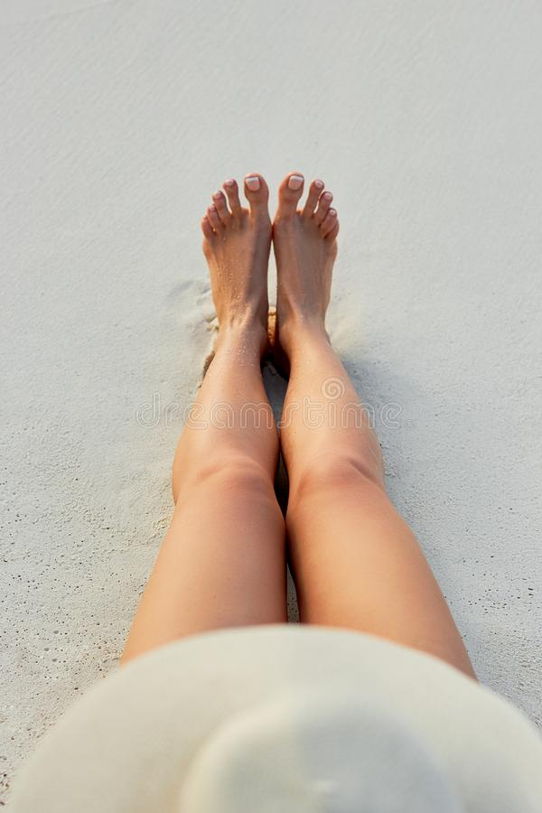 Free Women Beautiful Sexy Legs On The Beach. Skin Care And Protection Sun. Spa Concep. Royalty Free Stock Photography - 143697837