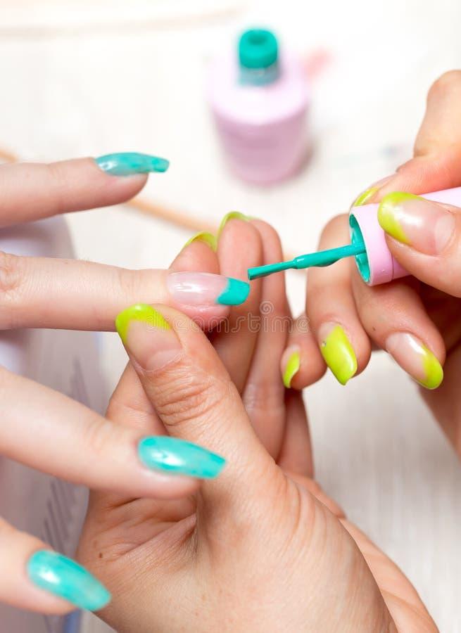 Women in a beauty salon manicure stock photos