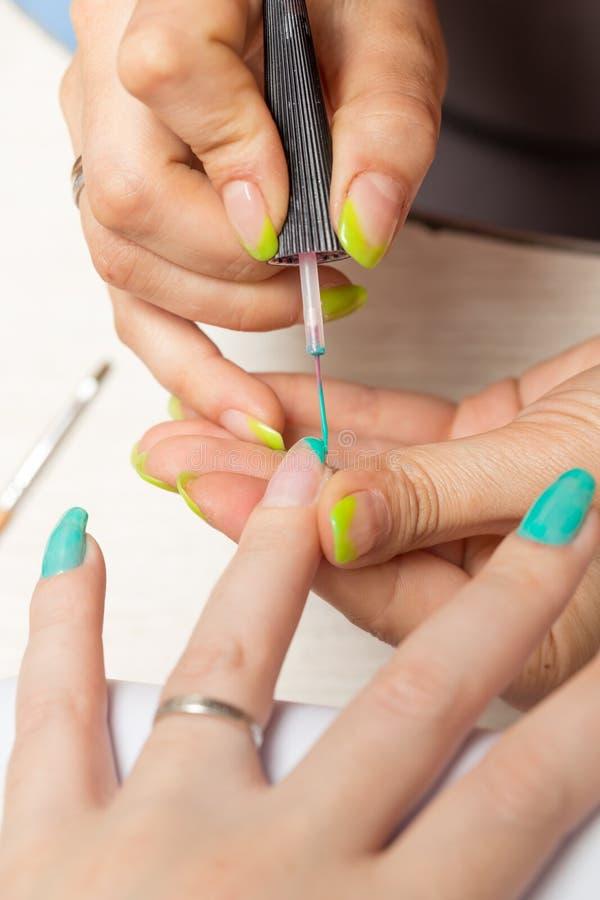 Women in a beauty salon manicure stock image