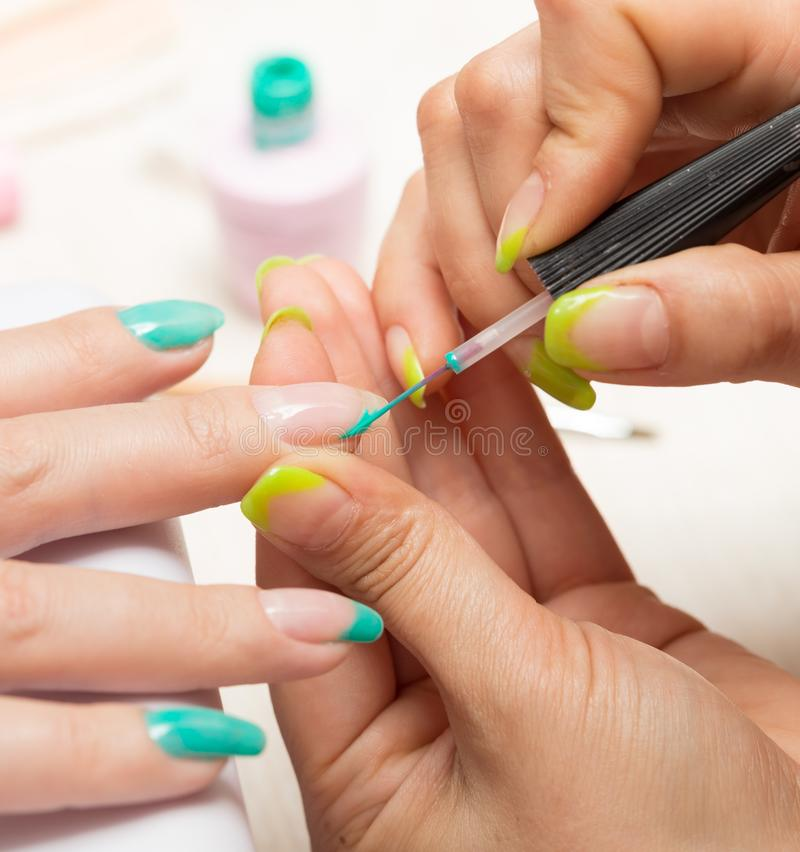 Women in a beauty salon manicure stock images