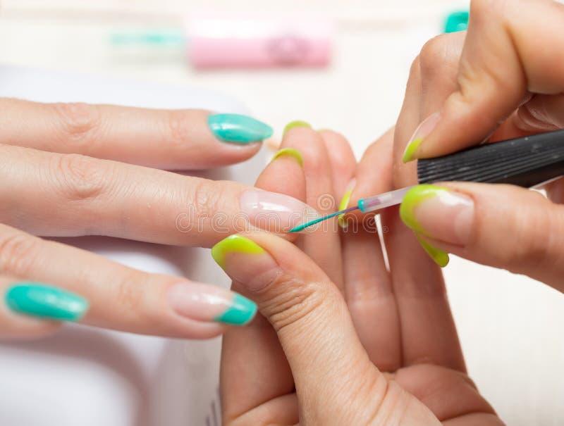 Women in a beauty salon manicure royalty free stock image