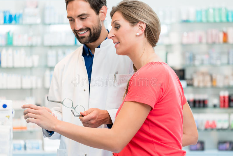 Women being helped by pharmacist to choose right remedy stock photos