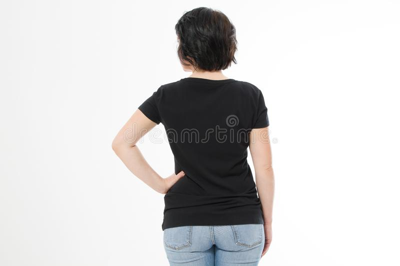 Women black blank t shirt, rear back view isolated on white background. Template shirt, copy space and mock up for print design stock images