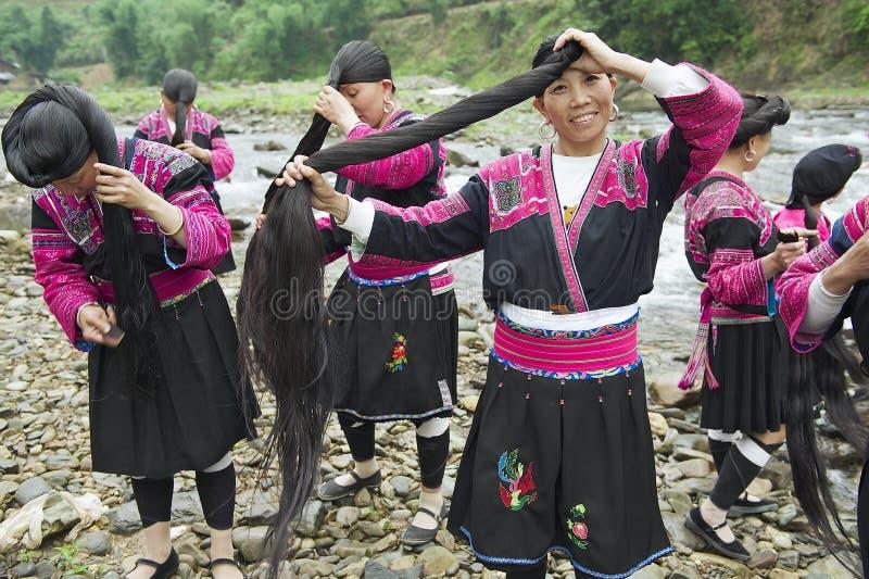 Women brush and style hair in Longji, China. LONGJI, CHINA - MAY 06, 2009: Unidentified women brush and style hair on May 06, 2009 in Longji, China. Women of stock image