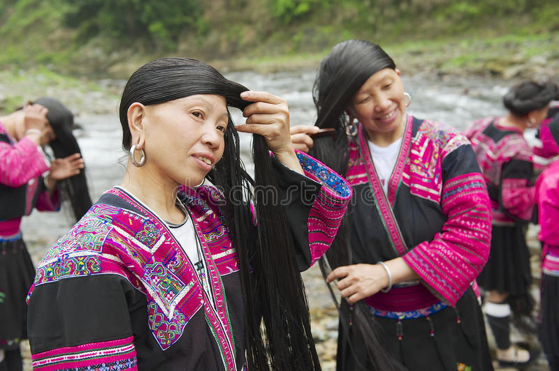 Women brush and style hair in Longji, China. royalty free stock photo