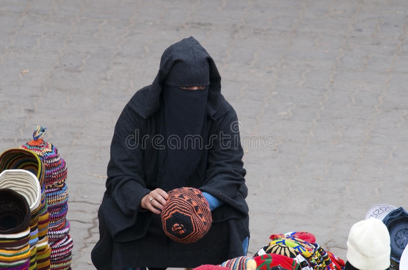 Women with burka, Marrakesh Morocco stock images